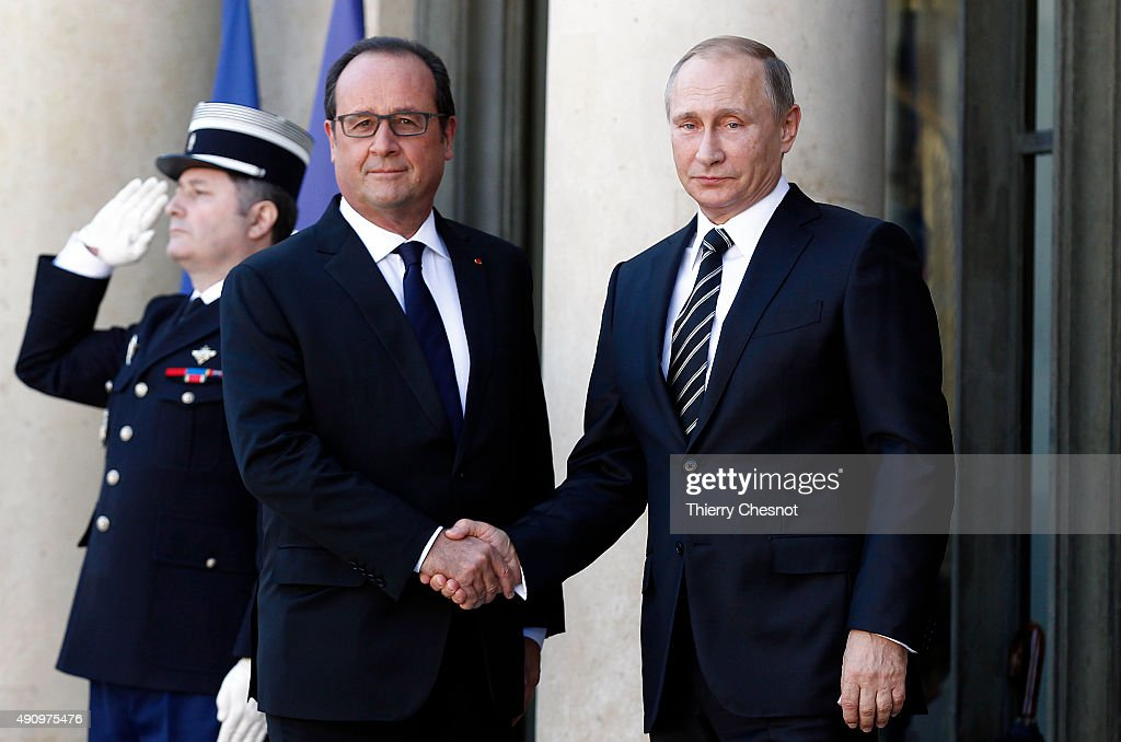 French President Francois Hollande welcomes Russian President, Vladimir Putin prior to their meeting at the Elysee Presidential Palace on October 02, 2015 in Paris, France. The leaders of France, Germany, Russia and Ukraine meet in Paris to consolidate a fragile peace in Ukraine, as a conflict that appears to be winding down is overshadowed by President Vladimir Putin's dramatic intervention in Syria's war.