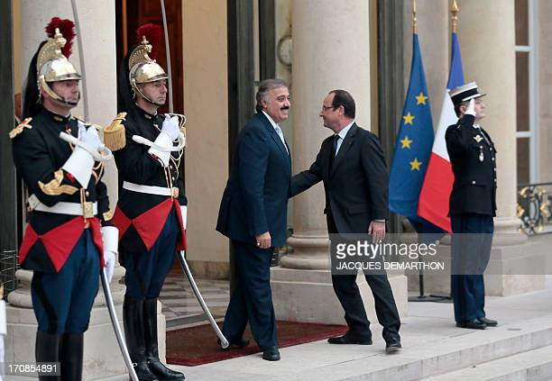 French President Francois Hollande welcomes Saudi Prince Mutaib bin Abdullah al Saud at the Elysee Presidential Palace on June 19 2013 in Paris for...