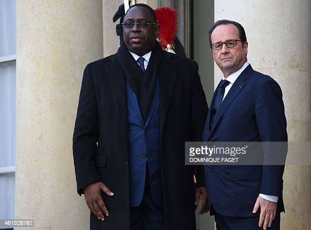 French President Francois Hollande welcomes Senegal President Macky Sall at the Elysee Palace before attending a Unity rally Marche Republicaine on...