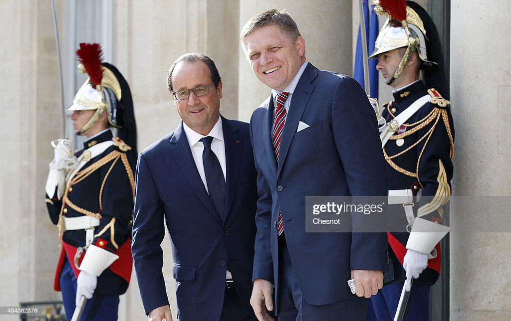 French president Francois Hollande (L) welcomes Slovak Prime Minister <a gi-track='captionPersonalityLinkClicked' href=/galleries/search?phrase=Robert+Fico&family=editorial&specificpeople=555594 ng-click='$event.stopPropagation()'>Robert Fico</a> at the Elysee presidential palace on August 30, 2014 in Paris, France. Francois Hollande host a meeting with European centre-left leaders to forge a common position ahead of the Brussels summit.