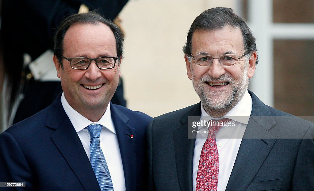 French President Francois Hollande welcomes Spanish Prime Minister Mariano Rajoy upon his arrival for a FrenchSpanish summit at the Elysee Palace on...