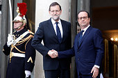 French President Francois Hollande welcomes Spanish Prime Minister Mariano Rajoy at the Elysee Palace before attending a Unity rally in tribute to...