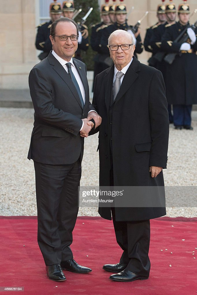 French President Francois Hollande (L) welcomes Tunisian President <a gi-track='captionPersonalityLinkClicked' href=/galleries/search?phrase=Beji+Caid+Essebsi&family=editorial&specificpeople=998512 ng-click='$event.stopPropagation()'>Beji Caid Essebsi</a> (R) to the State Dinner in honor of the Tunisian President at Elysee Palace on April 7, 2015 in Paris, France. The President of Tunisia <a gi-track='captionPersonalityLinkClicked' href=/galleries/search?phrase=Beji+Caid+Essebsi&family=editorial&specificpeople=998512 ng-click='$event.stopPropagation()'>Beji Caid Essebsi</a> started a 2 days visit on April 7th.