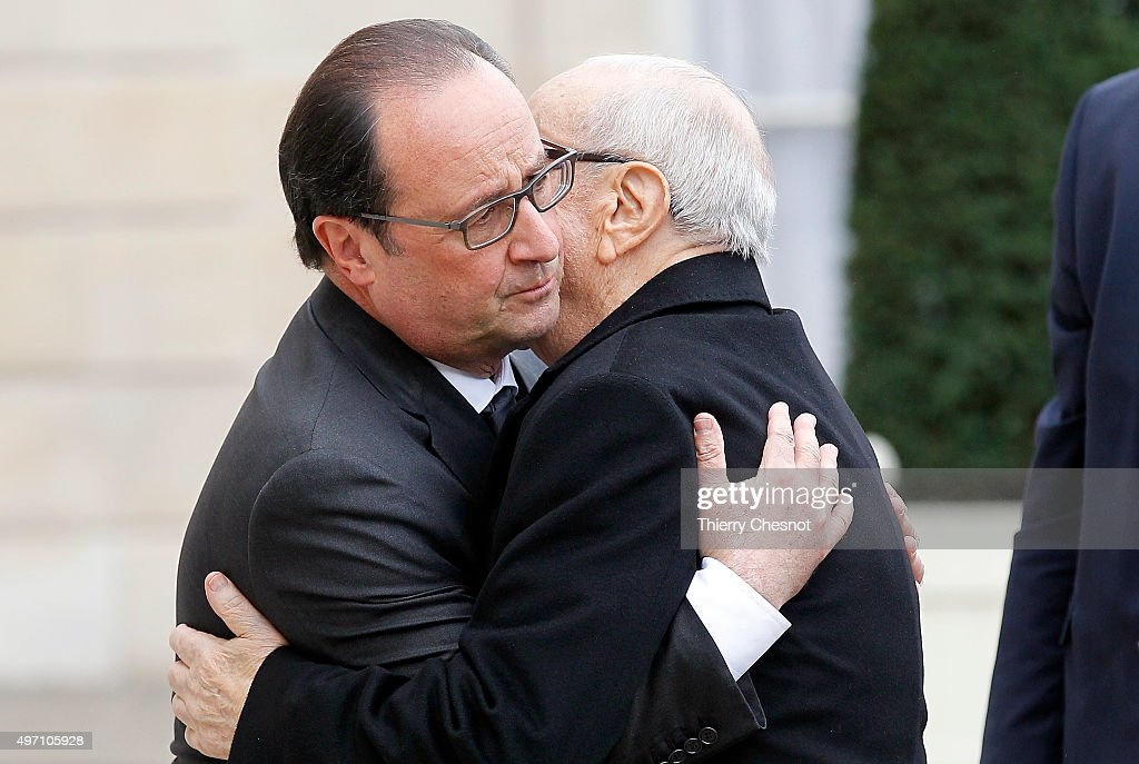 French President Francois Hollande (L) welcomes Tunisian President Beji Caid El Sebsi on November 14, 2015 in Paris, France. This meeting follows a series of coordinated attacks in and throughout Paris which left more than 120 people dead. Hollande on November 14 blamed the Islamic State group for the attacks in Paris that left at least 128 dead, calling them an 'act of war'.