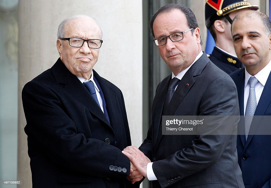 French President Francois Hollande (R) welcomes Tunisian President Beji Caid El Sebsi on November 14, 2015 in Paris, France. This meeting follows a series of coordinated attacks in and throughout Paris which left more than 120 people dead. Hollande on November 14 blamed the Islamic State group for the attacks in Paris that left at least 128 dead, calling them an 'act of war'.