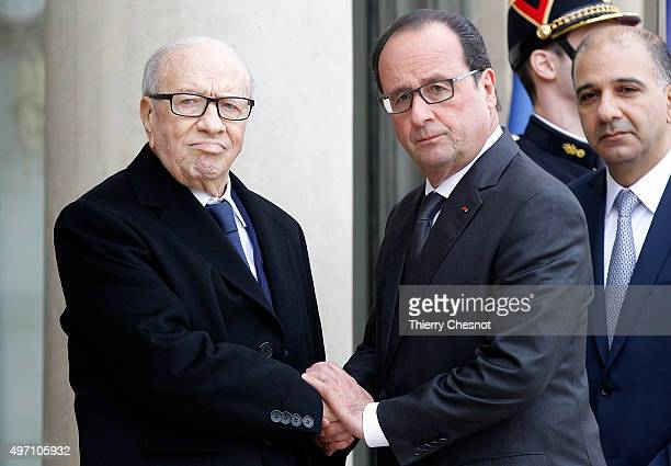 French President Francois Hollande welcomes Tunisian President Beji Caid El Sebsi on November 14 2015 in Paris France This meeting follows a series...