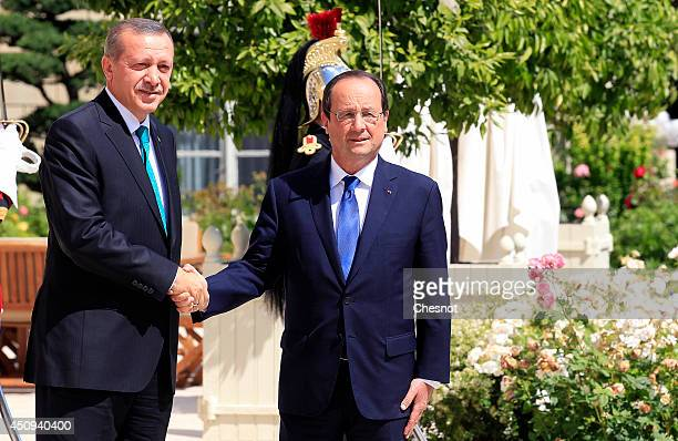 French President Francois Hollande welcomes Turkish Prime Minister Recep Tayyip Erdogan at the Elysee Palace on June 20 2014 in Paris France Tayyip...