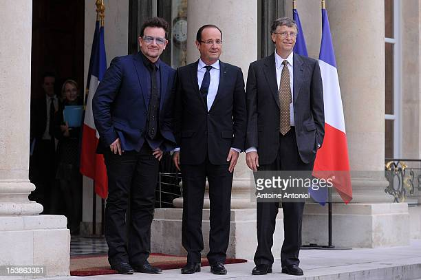 French President Francois Hollande welcomes U2 Frontman Bono and Microsoft Corp Chairman Bill Gates at the Elysee Palace on October 10 2012 in Paris...