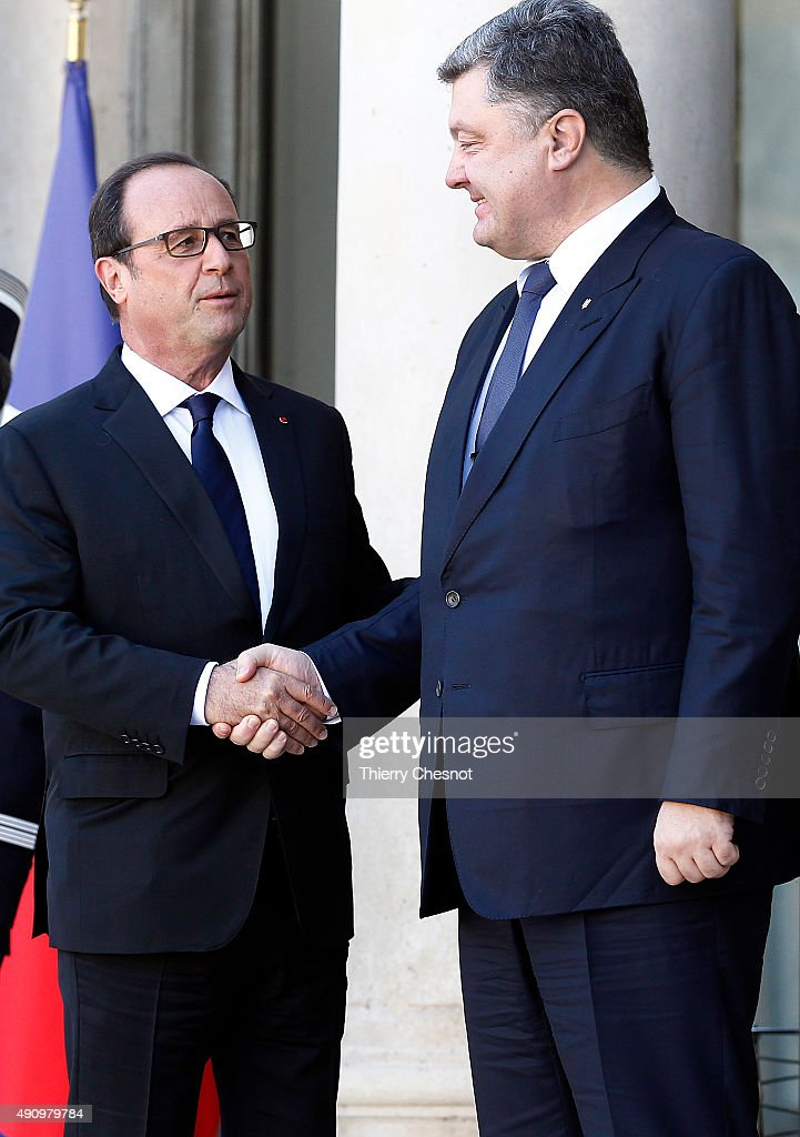French President Francois Hollande welcomes Ukrainian President Petro Poroshenko prior to their meeting at the Elysee Presidential Palace on October 02, 2015 in Paris, France. The leaders of France, Germany, Russia and Ukraine are meeting in Paris to consolidate a fragile peace in Ukraine, as a conflict that appears to be winding down is overshadowed by President Vladimir Putin's dramatic intervention in Syria's war.