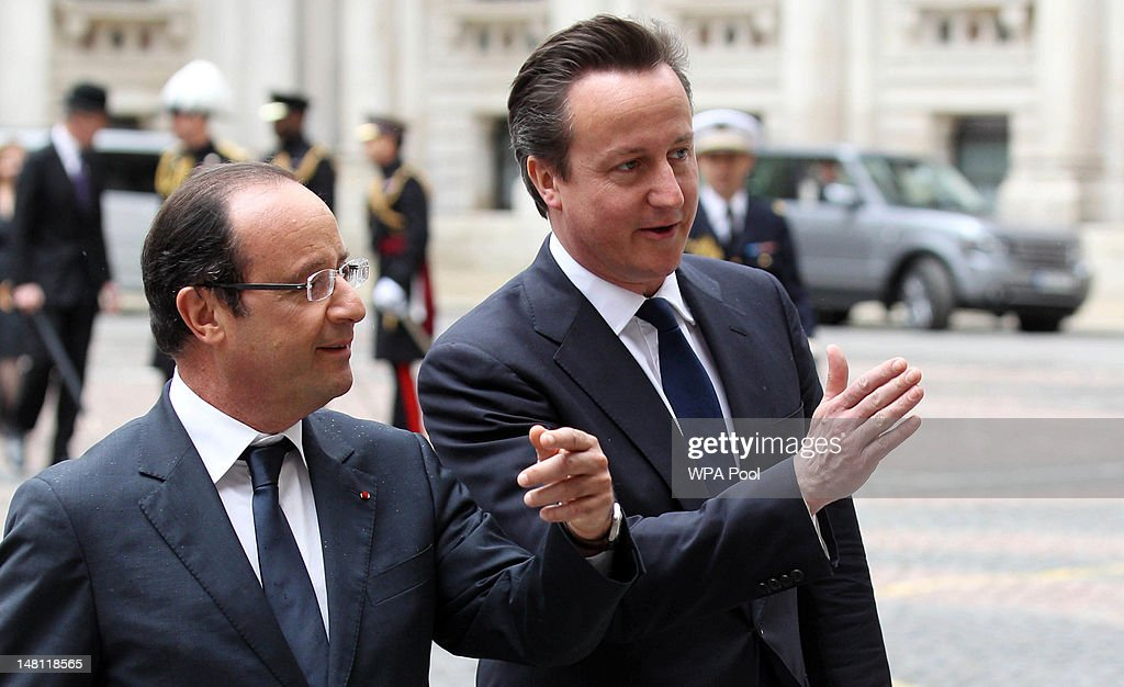 French President Francois Hollande (left) with Prime Minister <a gi-track='captionPersonalityLinkClicked' href=/galleries/search?phrase=David+Cameron+-+Politician&family=editorial&specificpeople=227076 ng-click='$event.stopPropagation()'>David Cameron</a> at the Foreign and Commonwealth Office on July 10, 2012 in London, England. This is the French President's first official visit to the United Kingdom since taking office, during which he will attend meetings with British Prime Minister <a gi-track='captionPersonalityLinkClicked' href=/galleries/search?phrase=David+Cameron+-+Politician&family=editorial&specificpeople=227076 ng-click='$event.stopPropagation()'>David Cameron</a> and Queen Elizabeth II.