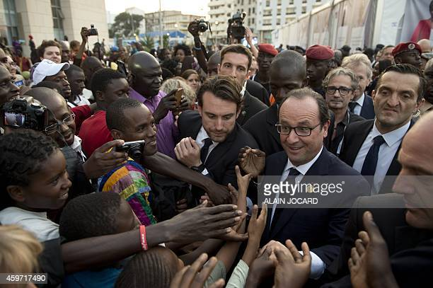 French President Francois Hollande works the crowd on November 29 at the Francophony village in Dakar on the steps of the Francophony summit AFP...