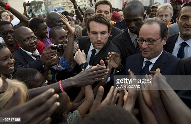 French President Francois Hollande works the crowd on November 29 in Dakar on the steps of the Francophony summit AFP PHOTO / ALAIN JOCARD