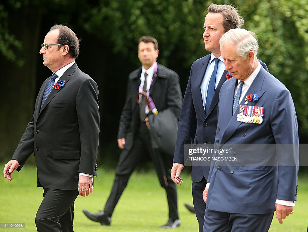 French President Francois Hollande,Britain's Prime Minister David Cameron and Britain's Prince Charles march towards the Thiepval Memorial on July 1, 2016 to attend a ceremony marking the 100th anniversary of the World War I battle at the River Somme. Under grey skies, unlike the clear sunny day that saw the biggest slaughter in British military history a century ago, the commemoration kicked off at the deep Lochnagar crater, created by the blast of mines placed under German positions two minutes before the attack began at 7:30 am on July 1, 1916. / AFP / FRANCOIS