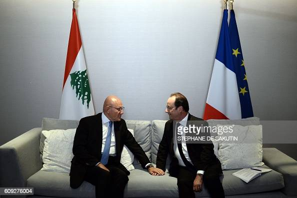 TOPSHOT French President Francois Hollandemeets with Tammam Salam Prime Minister of Lebanon on the sidelines of the 71st session of the UN General...
