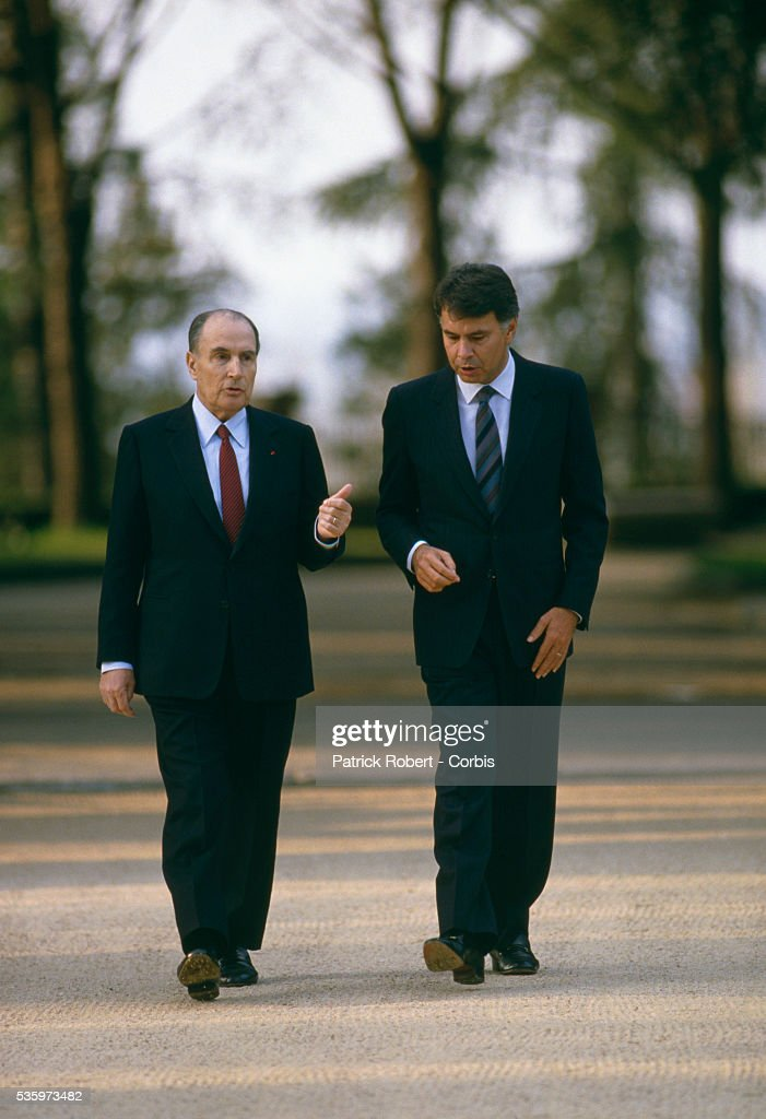 French President Francois Mitterrand (L) and Spanish Prime Minister, Felipe Gonzalez converse as they walk in Madrid. The French and Spanish leaders are meeting in Madrid for the 1987 Franco-Spanish Summit. | Location: Madrid, Spain.