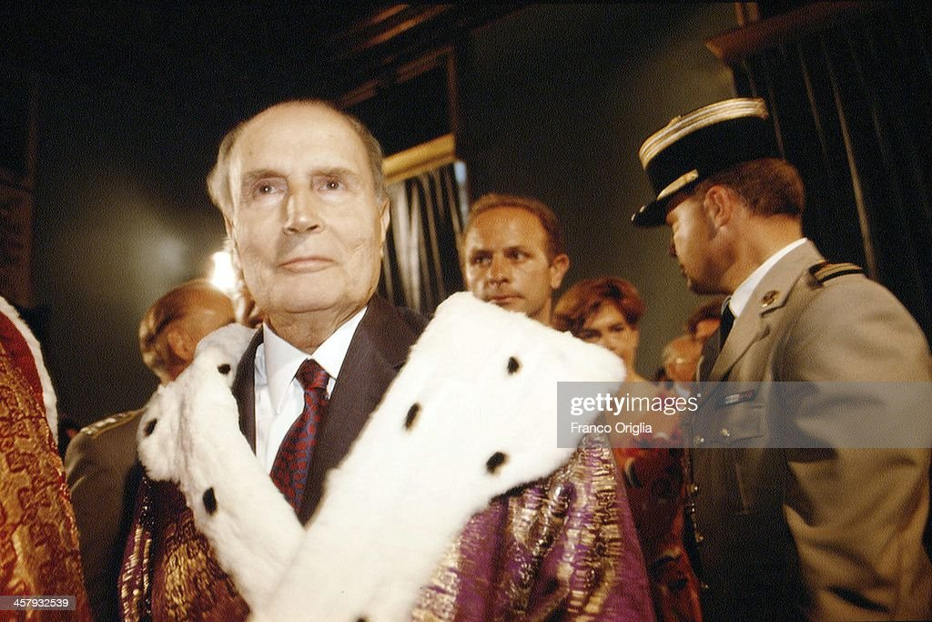 French President <a gi-track='captionPersonalityLinkClicked' href=/galleries/search?phrase=Francois+Mitterrand&family=editorial&specificpeople=208938 ng-click='$event.stopPropagation()'>Francois Mitterrand</a> receives an Horonis Causa degree in philosophy by the Universitˆ degli Studi di Napoli 'L'Orientale' during the G7 Summit on July 8, 1994 in Naples, Italy.