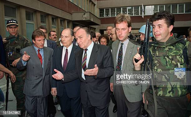 French President Francois Mitterrand surrounded by his Bosnian security guards and his personal body guard Daniel Gamba is accompanied by his Bosnian...