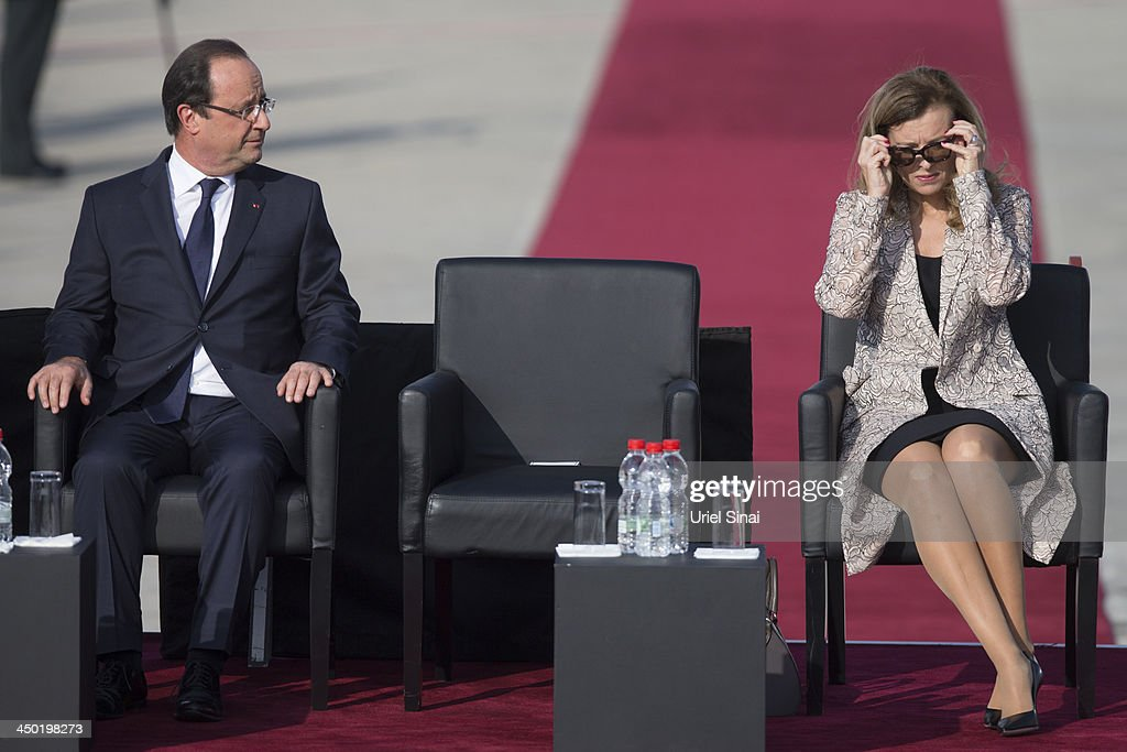 French President Francois sits next to his companion <a gi-track='captionPersonalityLinkClicked' href=/galleries/search?phrase=Valerie+Trierweiler&family=editorial&specificpeople=8534231 ng-click='$event.stopPropagation()'>Valerie Trierweiler</a> on his arrival at Ben Gurion International Airport on November 17, 2013 in Tel Aviv, Israel. Hollande landed at Israel's Ben Gurion airport for a three-day visit in Israel and the West Bank.