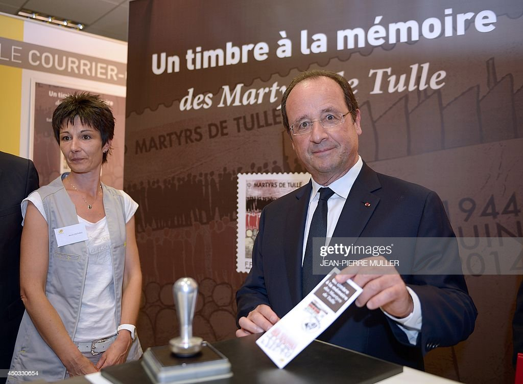 French President François Hollande attends the presentation of a stamp on June 9, 2014 in Tulle, , southwestern France, in tribute to the memory of Nazi victims in Tulle. On June 9, 1944, 99 hostages were hanged from lampposts and balconies by the SS Division Das Reich in Tulle.