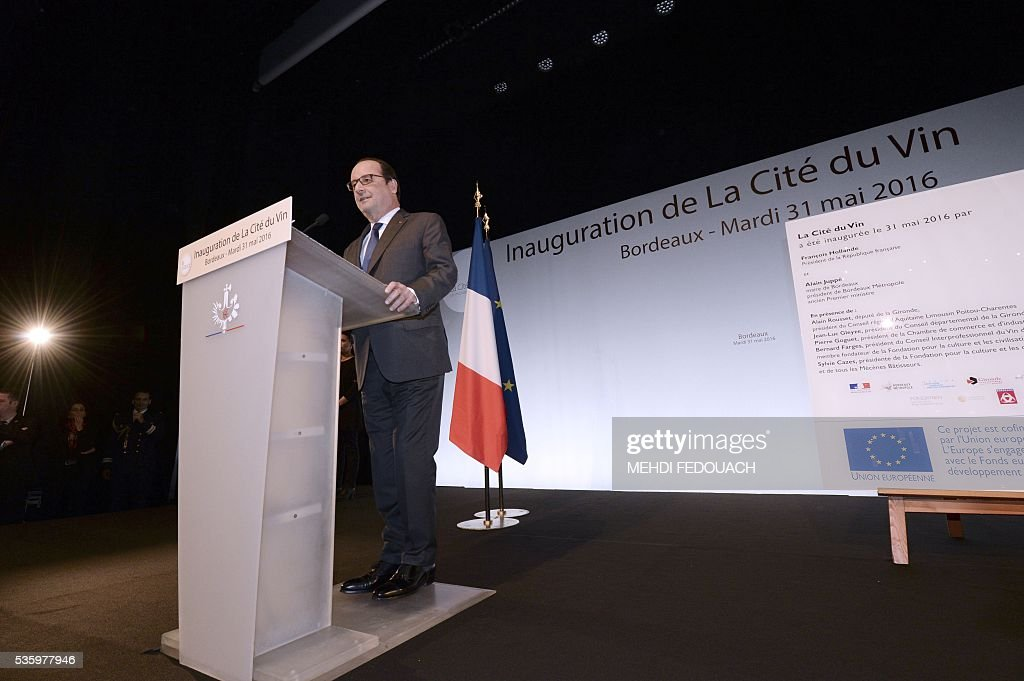 French President François Hollande delivers a speech during the inauguration of the Cite du Vin (Wine Museum) on May 31, 2016 in Bordeaux, western France. New cultural, touristic and architectural symbol of Bordeaux, the Wine Museum, would like to attract 450,000 visitors per year. It will open on June 1. / AFP / POOL / MEHDI