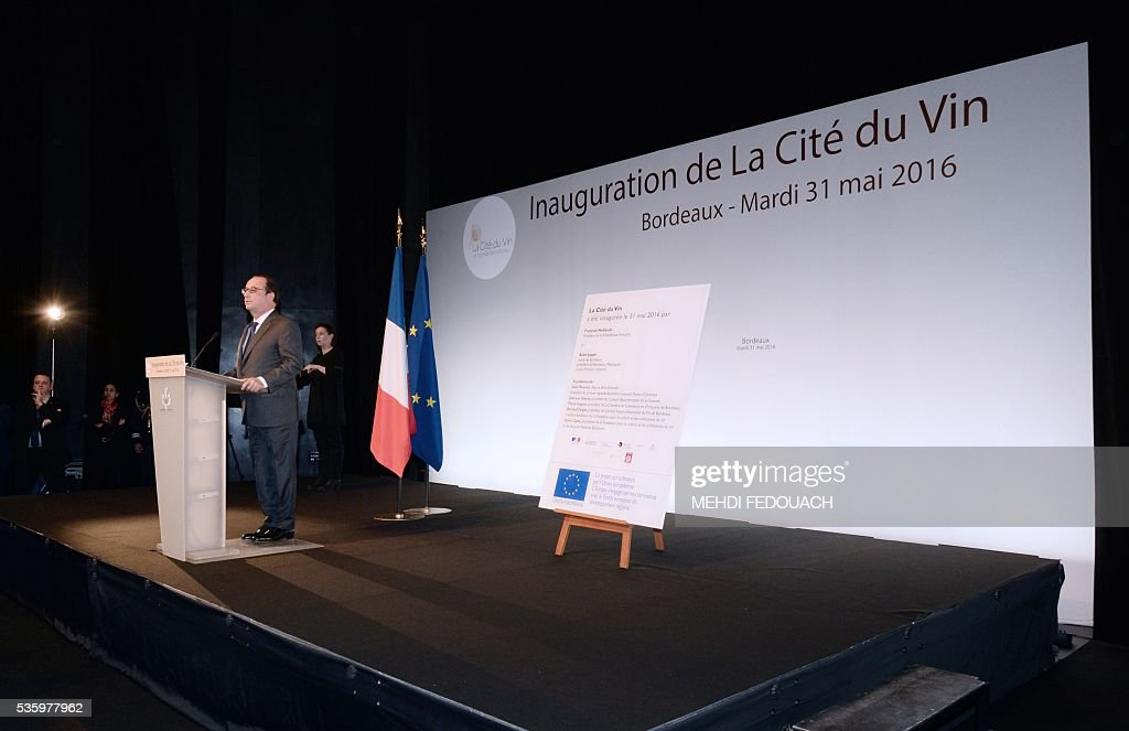 French President François Hollande delivers a speech during the inauguration of the Cite du Vin (Wine Museum) on May 3, 2016 in Bordeaux, western France. New cultural, touristic and architectural symbol of Bordeaux, the Wine Museum, would like to attract 450,000 visitors per year. It will open on June 1. / AFP / POOL / MEHDI