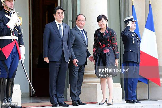 French President Franois Hollande greets Japanese Prime Minister Shinzo Abe and his Wife Akie Abe at the state Dinner At Elysee Palace In Honor Of...