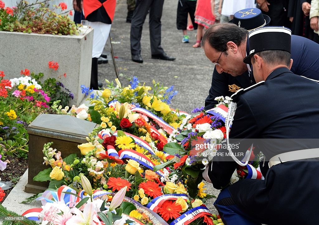 French President François Hollande lays a wreath in front of a stele during a ceremony to the memory of Nazi victims on June 9, 2014 in Tulle, southwestern France. 99 hostages were hanged from lampposts and balconies by the SS Division Das Reich in Tulle, on June 9, 1944, during the WWII.