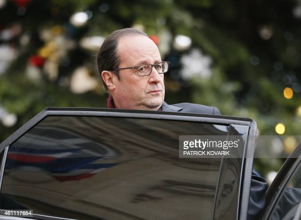 French president François Hollande leaves the Palais de l'Elysee to go to the French satirical newspaper Charlie Hebdo in Paris on January 7 after...