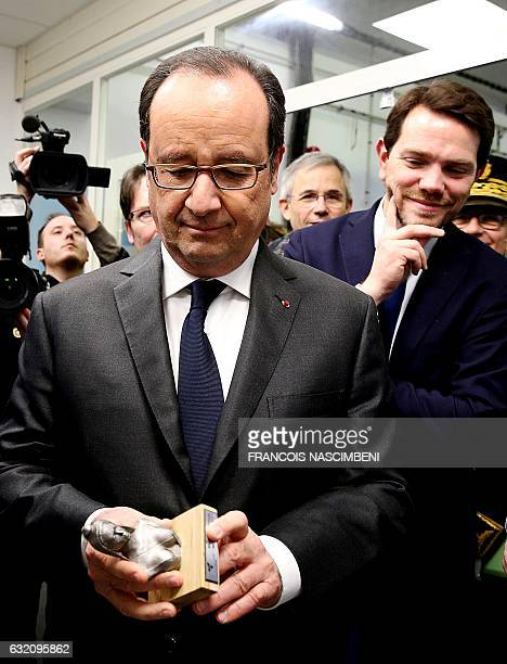 French President François Hollande receives a 3D printed statue of Marianne the national symbol of the French Republic during a visit at the French...