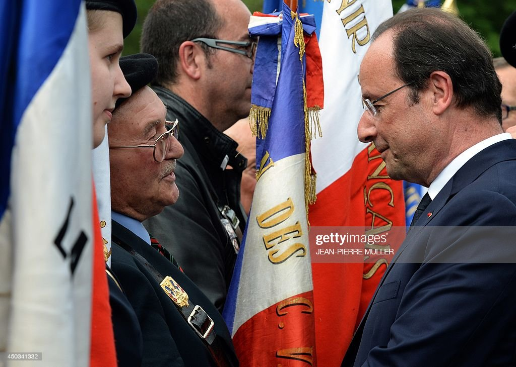 French President François Hollande (R)speaks to Veterans during a ceremony to the memory of Nazi victims on June 9, 2014 in Tulle, southwestern France. 99 hostages were hanged from lampposts and balconies by the SS Division Das Reich in Tulle, on June 9, 1944, during the WWII.