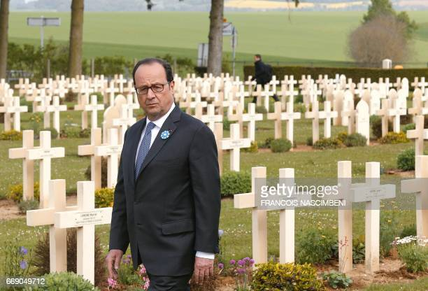 French President François Hollande visits the French military cemetery in CernyenLaonnois north eastern France during the commemorations of the 100th...
