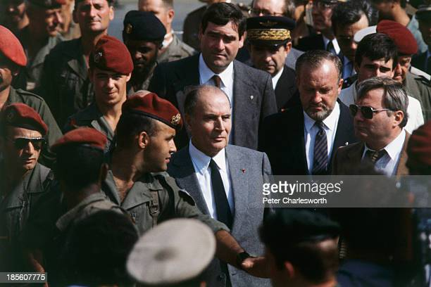 French President François Mitterrand visits what remained of the eightstory 'Drakkar' building which had been used as the French military's...