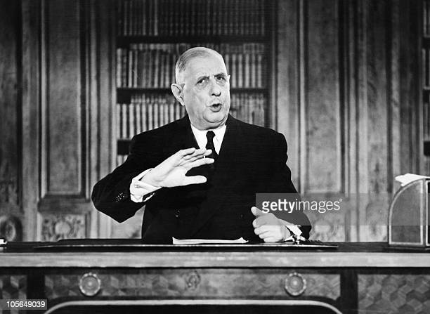 French President General Charles de Gaulle gestures while addressing the nation during a TV speech on the eve of the New Year 1963 on December 31...
