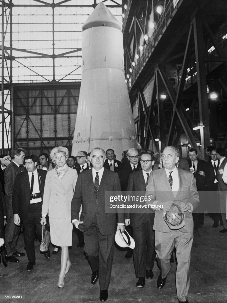 French President Georges Pompidou (1911 - 1974, centre) and his wife, Claude (1912 - 2007) visiting the Kennedy Space Center in Florida, USA, 26th February 1970. Behind them is part of the Apollo 13 rocket, which is due to be launched in April. Giving the tour is KSC director, Kurt H. Debus (1908 - 1983, right). Debus was one of over 1600 German scientists and engineers to be recruited by the United States at the end of World War II, as part of Operation Paperclip.