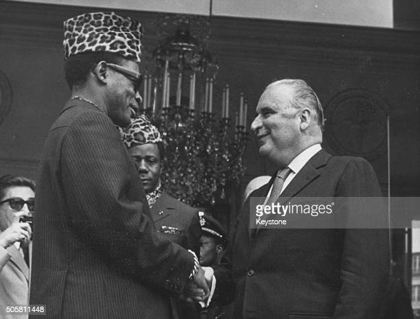 French President Georges Pompidou shaking hands with Mobutu Sese Seko President of Zaire at the Elysee Palace in Paris circa 1970