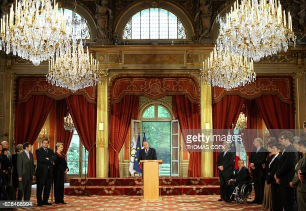 French President Jacques Chirac addresses French Defence minister Michèle AlliotMarie French Sports minister JeanFrancois Lamour and the athletes and...