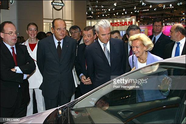 French president Jacques Chirac at the 2002 Paris auto show In Paris France On September 27 2002 Jean Martin Folz Jacques Chirac Claude Satinet...