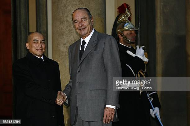 French President Jacques Chirac greets Cambodian King Norodom Sihamoni outside the Elysee Palace ahead of a gala dinner in the King's honour