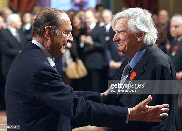 French president Jacques Chirac greets Turkish founder of Parisbased photography agency Sipa Goksin Sipahioglu after awarding him as knight of the...