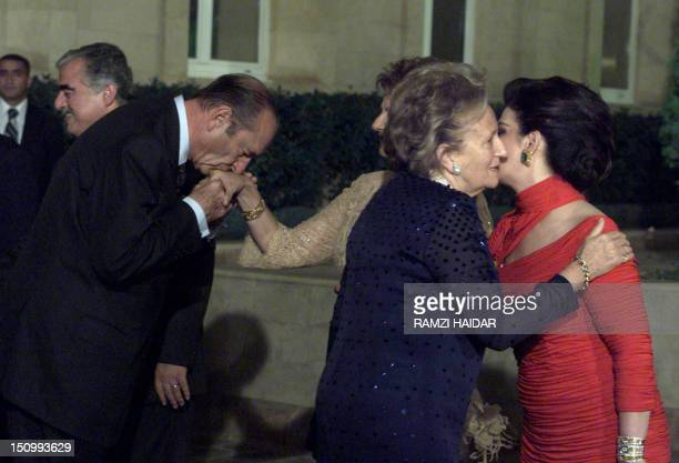 French President Jacques Chirac kisses the hand of Lebanese First Leady Andree Lahoud as his wife Bernadette embraces the wife of Lebanese Prime...