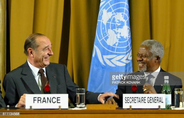 French President Jacques Chirac laughs with UN General Secretary Kofi Annan as they give a press conference with Chilean President Ricardo Lagos...