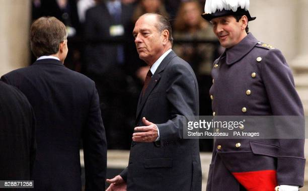 French President Jacques Chirac with British Prime Minister Tony Blair during an inspection of the Guard of Honour by Grenadier Guards at the Foreign...