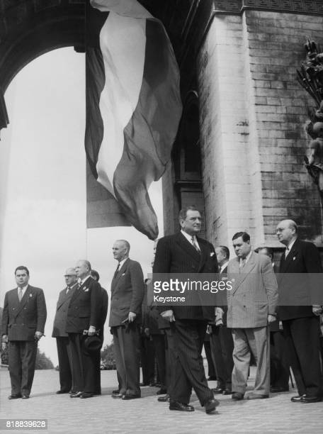 French President Joseph Laniel leaves the Arc de Triomphe in Paris with members of his cabinet having placed a wreath on the Tomb of the Unknown...