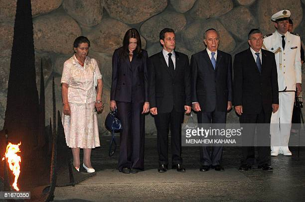 French President Nicolas Sarkozy accompanied by his wife Carla BruniSarkozy and French philosopher and Holocaust survivor Simone Weil Israeli...