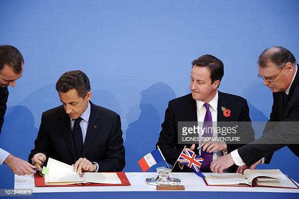 French President Nicolas Sarkozy and British Prime Minister David Cameron sign treaties during an AngloFrench summit at Lancaster House in central...