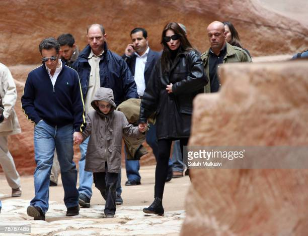 French President Nicolas Sarkozy and Carla Bruni accompanied by her son Aurelien Enthoven tour the ancient Nabatean city of Petra on January 05 2008...