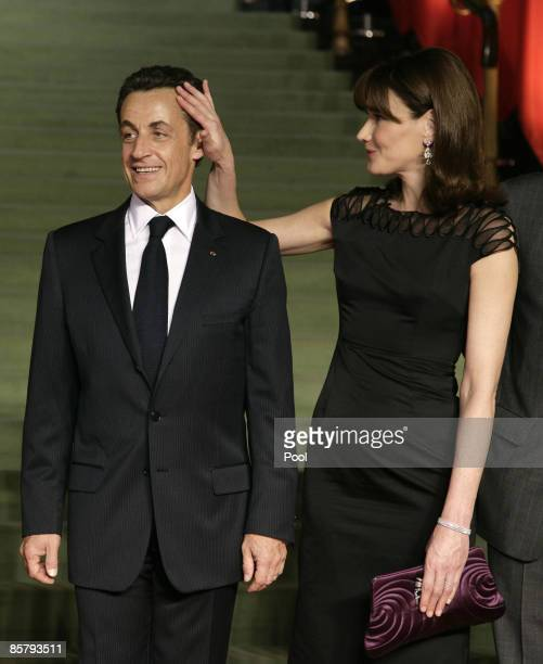 French President Nicolas Sarkozy and French first Lady Carla Bruni arrive to attend the opening of the NATO summit at the Kurhaus on April 3 2009 in...