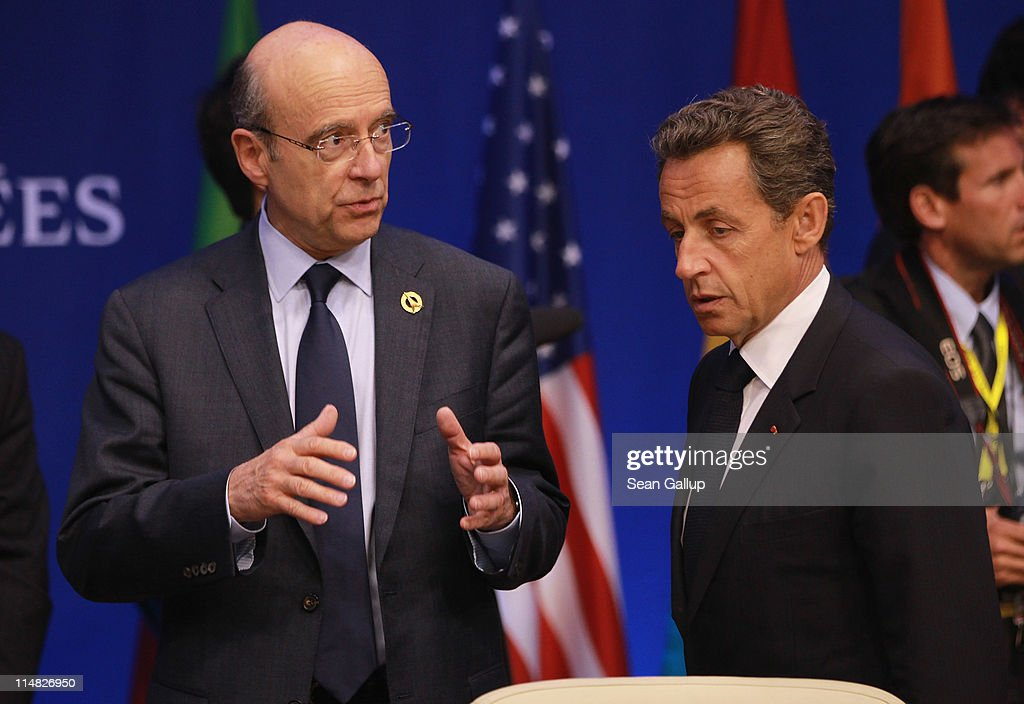 French President <a gi-track='captionPersonalityLinkClicked' href=/galleries/search?phrase=Nicolas+Sarkozy&family=editorial&specificpeople=211375 ng-click='$event.stopPropagation()'>Nicolas Sarkozy</a> (R) and French Foreign Minister <a gi-track='captionPersonalityLinkClicked' href=/galleries/search?phrase=Alain+Juppe&family=editorial&specificpeople=235359 ng-click='$event.stopPropagation()'>Alain Juppe</a> chat at a meeting of G8 leaders and African leaders on the second day of the G8 Summit on May 27, 2011 in Deauville, France. The Tunisian Prime Minister, Beji Caid el Sebsi, and Egyptian Prime Minister, Essam Sharaf, are due to meet with G8 leaders today to discuss aid packages as the recent Arab Spring uprisings continue to dominate the talks. Furthermore, the meeting will also continue to address security, trade issues, nuclear safety and climate change.