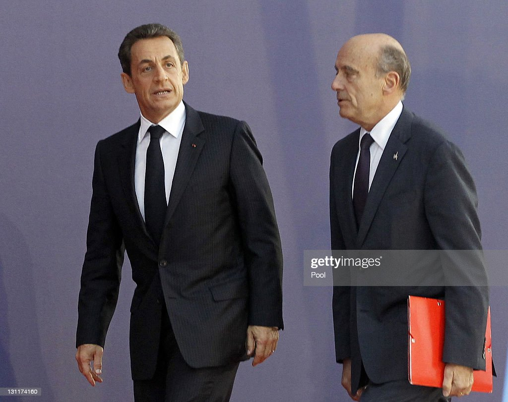 French President Nicolas Sarkozy and French Foreign Minister Alain Juppe arrive for talks with EU and IMF representatives on November 2 2011 in...