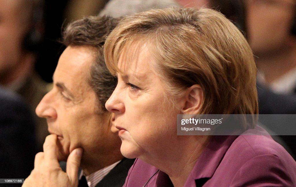 French President Nicolas Sarkozy and German Chancellor Angela Merkel attend the North Atlantic Meeting during the NATO Summit 2010 at Feira...